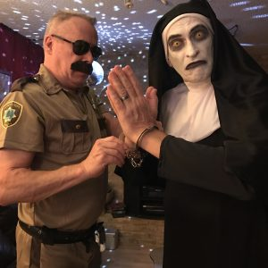 My husband Rick as Lt. Dangle from Reno 911!, and me (Jay) as the demon nun from The Conjuring 2.